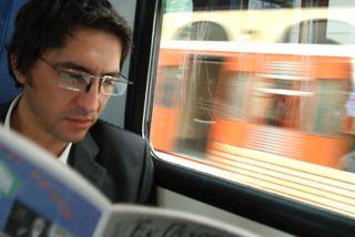 Man Reading Magazine MP900405138