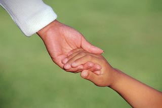 Mother Child Holding Hands MP900407459